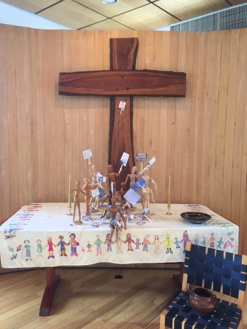 2017 Easter altar with articulated mannikins holding signs