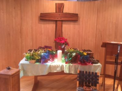 The altar-table filled with flowers on Easter Sunday